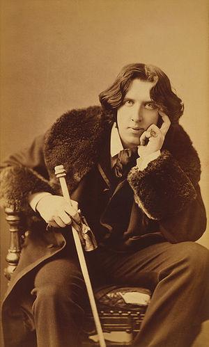 Three quarter length portrait of Oscar Wilde (...