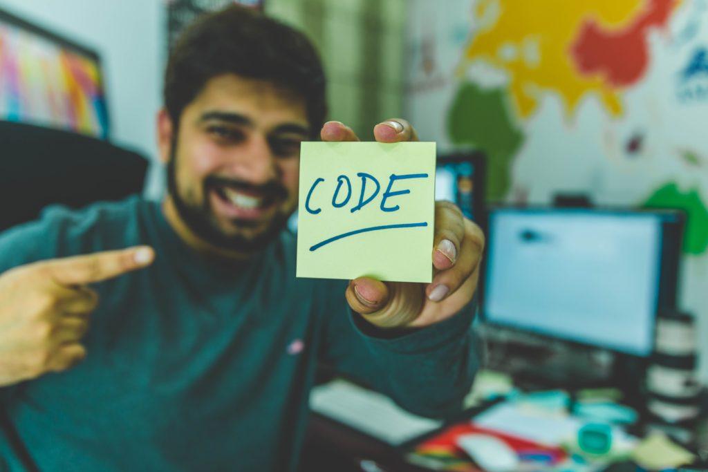 Bloke holding a CODE post-it, Hitesh Choudhary